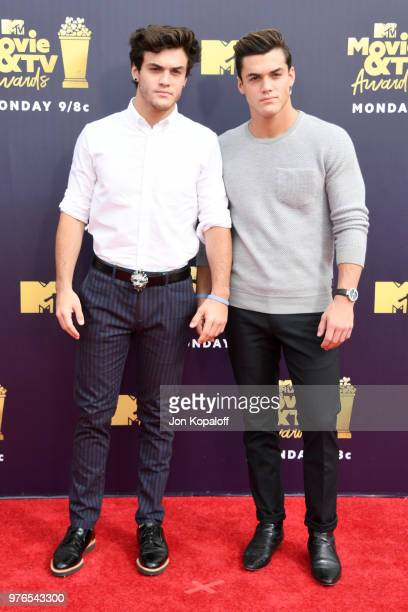 Ethan Dolan and Grayson Dolan attend the 2018 MTV Movie And TV Awards at Barker Hangar on June 16 2018 in Santa Monica California
