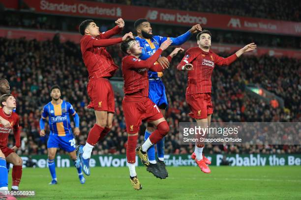 Ethan Ebanks-Landell of Shrewsbury challenges for a header with Ki-Jana Hoever of Liverpool , Neco Williams of Liverpool and Pedro Chirivella of...