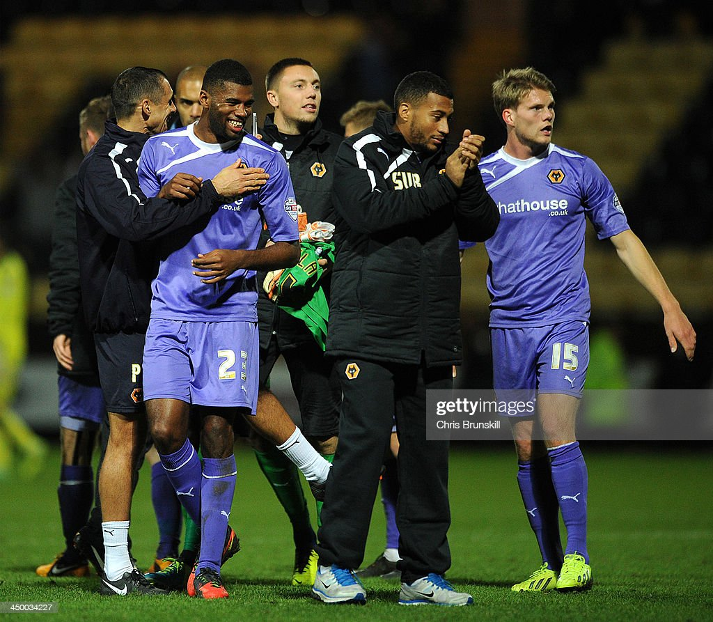 Ethan Ebanks-Landell (L) of Wolverhampton Wanderers celebrates at full-time following the Sky Bet League One match between Notts County and Wolverhampton Wanderers at Meadow Lane on November 16, 2013 in Nottingham, England.