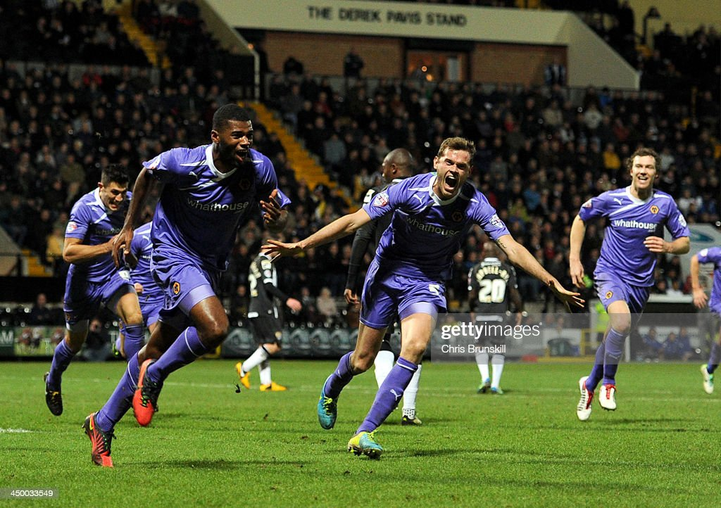 Ethan Ebanks-Landell (L) of Wolverhampton Wanderers celebrates scoring the opening goal during the Sky Bet League One match between Notts County and Wolverhampton Wanderers at Meadow Lane on November 16, 2013 in Nottingham, England.