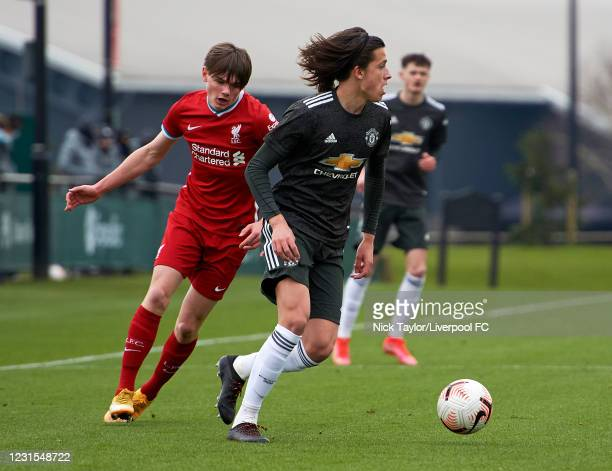 Ethan Ennis of Liverpool and Alvaro Fernandez of Manchester United in action during the U18 Premier League game between Liverpool and Manchester...