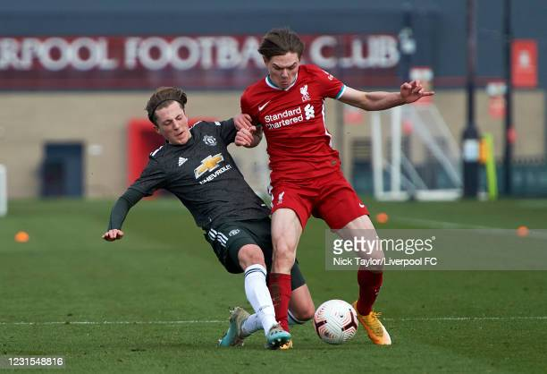 Ethan Ennis of Liverpool and Charlie Savage of Manchester United in action during the U18 Premier League game between Liverpool and Manchester United...
