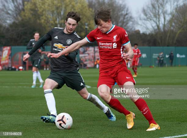 Ethan Ennis of Liverpool and Iestyn Hughes of Manchester United in action during the U18 Premier League game between Liverpool and Manchester United...