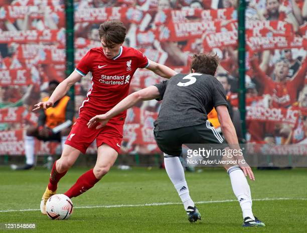 Ethan Ennis of Liverpool and Will Fish of Manchester United in action during the U18 Premier League game between Liverpool and Manchester United at...