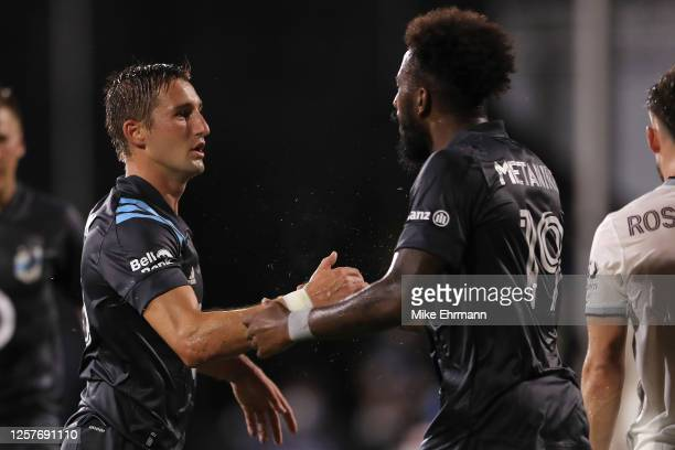 Ethan Finlay of Minnesota United celebrates with Romain Metanire after scoring the first goal of his team during a match against Colorado Rapids as...