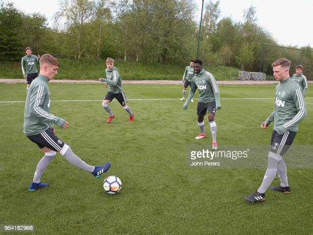 Ethan Galbraith Dion McGhee Aliou Traore and George Tanner at Aon Training Complex on May 2 2018 in Manchester England