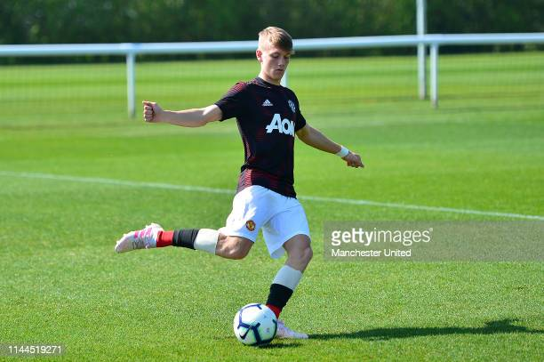 Ethan Galbraith of Manchester United U18s warms up ahead of the U18 Premier League match between Derby County U18s and Manchester United U18s on...
