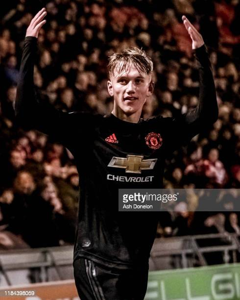 Ethan Galbraith of Manchester United U21s celebrates scoring their first goal during the Leasingcom Trophy match between Doncaster Rovers and...