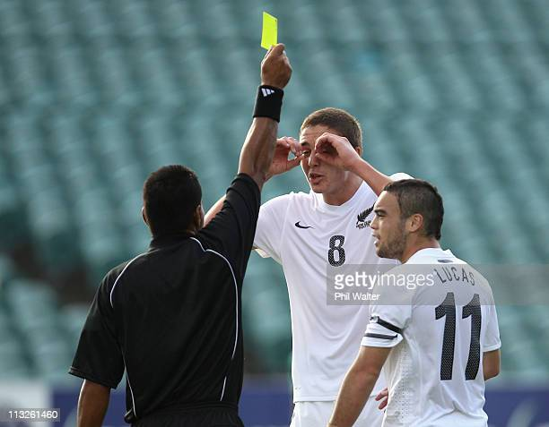 Ethan Galbraith of New Zealand disputes the yellow card during the Oceania Under 20 Tournament final match between New Zealand and Solomon Islands at...