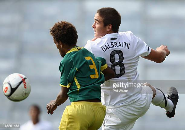 Ethan Galbraith of New Zealand headers the ball under pressure from Freddie Kini during the Oceania Under 20 Tournament final match between New...
