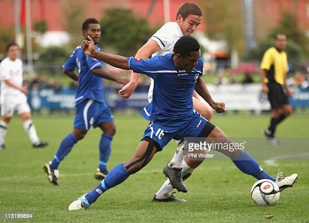 Ethan Galbraith of New Zealand puts preesure on Amani Valebalavu of Fiji during the Oceania Under 20 Tournament semi final match between New Zealand...