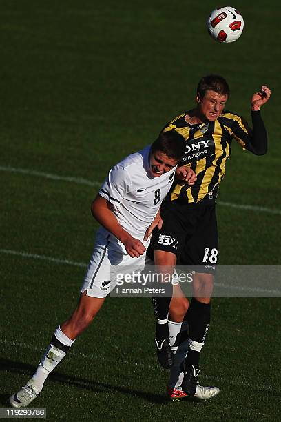 Ethan Galbraith of the Junior All Whites competes with Ben Sigmund of the Phoenix during the preseason friendly match between the Wellington Phoenix...