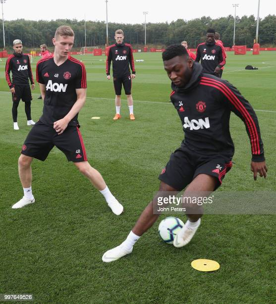 Ethan Hamilton and Timothy FosuMensah of Manchester United in action during a first team training session at Aon Training Complex on July 13 2018 in...