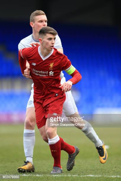 Ethan Hamilton of Man Utd grapples with Ben Woodburn of Liverpool during the UEFA Youth League Round of 16 match between Liverpool and Manchester...