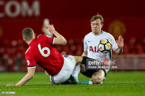 Ethan Hamilton of Manchester United and Oliver Skipp of Tottenham Hotspur in action during the Premier League 2 match between Manchester United and...