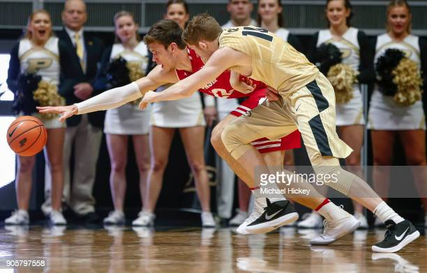 Ethan Happ of the Wisconsin Badgers and Ryan Cline of the Purdue Boilermakers chase down the loose ball during the game at Mackey Arena on January 16...