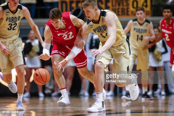 Ethan Happ of the Wisconsin Badgers battles for the ball against Isaac Haas of the Purdue Boilermakers at Mackey Arena on January 16 2018 in West...
