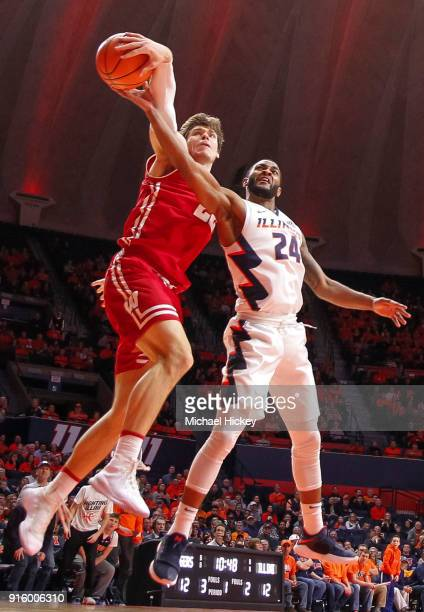 Ethan Happ of the Wisconsin Badgers blocks the shot of Mark Alstork of the Illinois Fighting Illini at State Farm Center on February 8 2018 in...