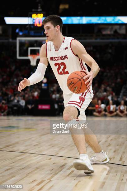 Ethan Happ of the Wisconsin Badgers dribbles the ball in the first half against the Nebraska Cornhuskers during the quarterfinals of the Big Ten...