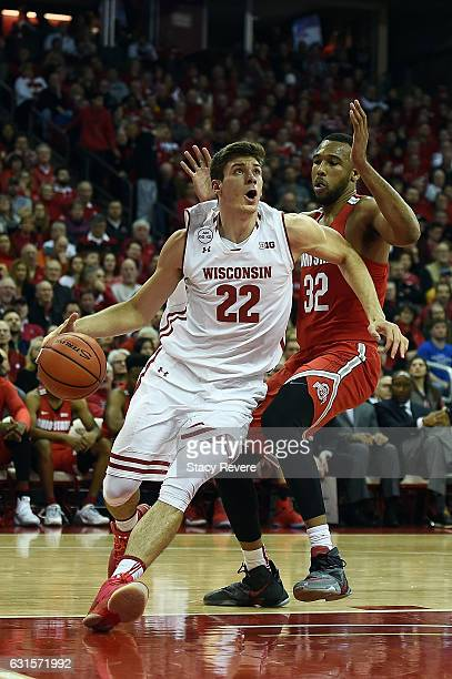 Ethan Happ of the Wisconsin Badgers drives to the basket against Trevor Thompson of the Ohio State Buckeyes during the first half of a game at the...