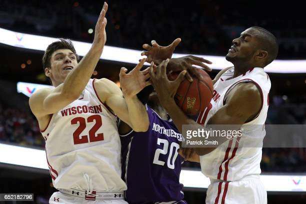 Ethan Happ of the Wisconsin Badgers Scottie Lindsey of the Northwestern Wildcats and Vitto Brown of the Wisconsin Badgers battle for a rebound during...