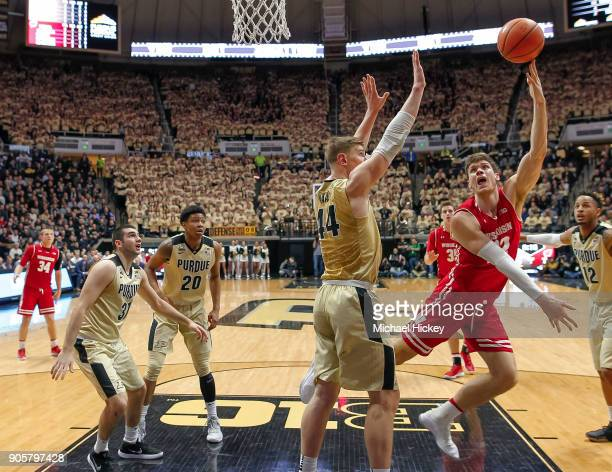 Ethan Happ of the Wisconsin Badgers shoots the ball against Isaac Haas of the Purdue Boilermakers at Mackey Arena on January 16 2018 in West...