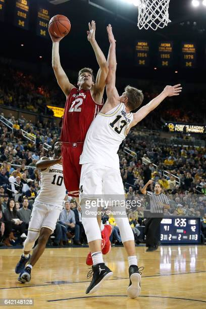 Ethan Happ of the Wisconsin Badgers takes a shot over Moritz Wagner of the Michigan Wolverines during the second half at Crisler Center on February...