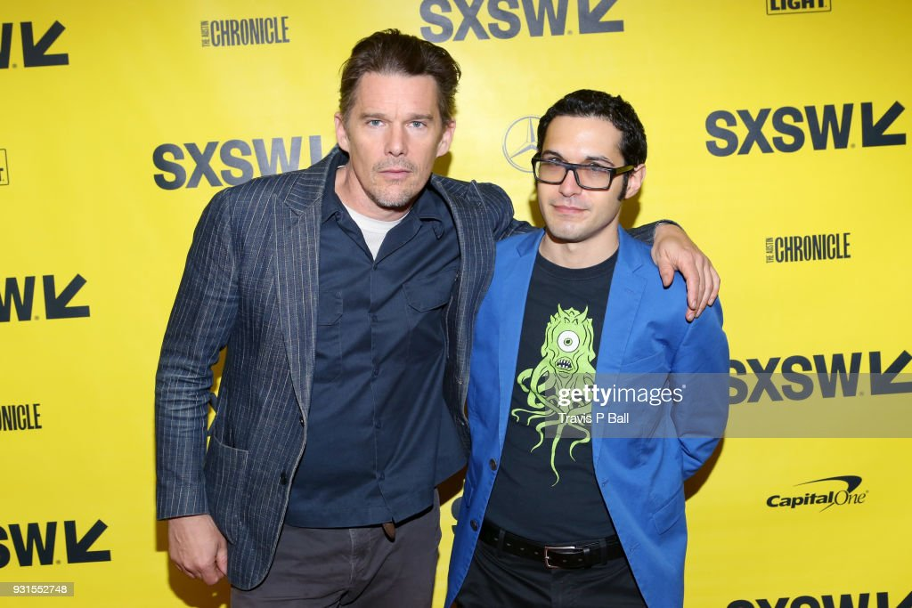 Ethan Hawke (L) and Eric Kohn attend SXSW at Austin Convention Center on March 13, 2018 in Austin, Texas.