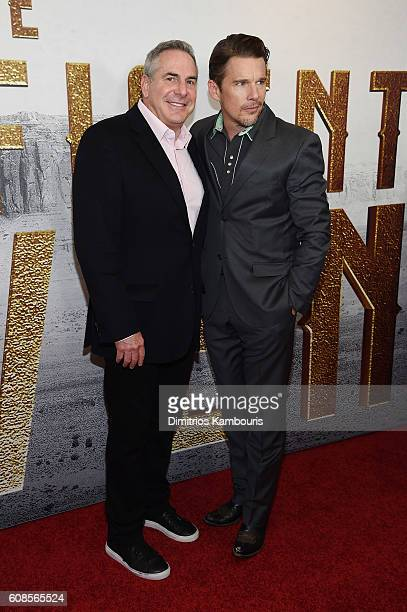 Ethan Hawke and Roger Birnbaum attend The Magnificent Seven premiere at Museum of Modern Art on September 19 2016 in New York City