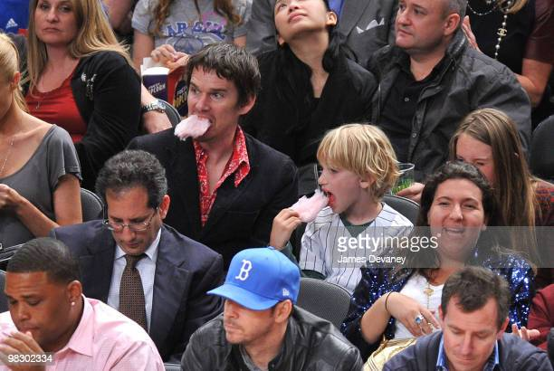 Ethan Hawke and son Levon Roan Hawke attend a game between the Boston Celtics and the New York Knicks at Madison Square Garden on April 6 2010 in New...
