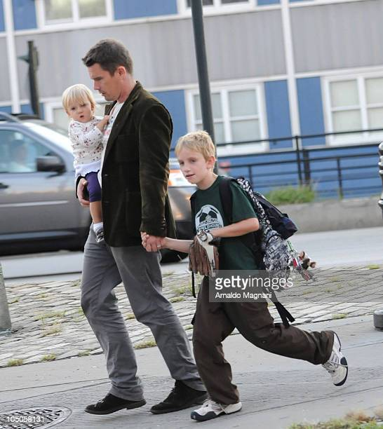 Ethan Hawke walks with his daughter Clementine Jane Hawke and son Levon Roan Thurman-Hawke in Midtown Manhattan on October 7, 2010 in New York City.