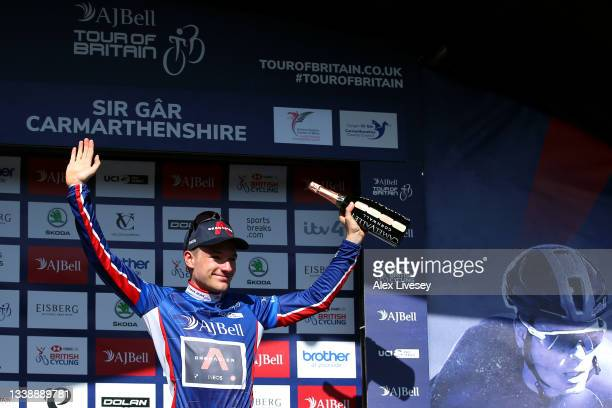 Ethan Hayter of United Kingdom and Team INEOS Grenadiers celebrates winning the blue leader jersey on the podium ceremony after the 17th Tour of...
