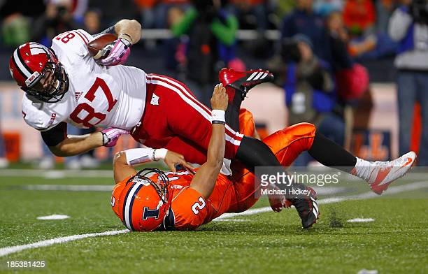 e6e9a9521 Ethan Hemer of the Wisconsin Badgers picks up a fumble from Nathan  Scheelhaase of the Illinois