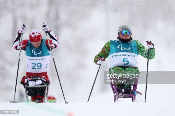 Ethan Hess of Canada left and Valiantsina Shyts of Belarus ski during Cross Country Skiing training ahead of the PyeongChang 2018 Paralympic Games at...