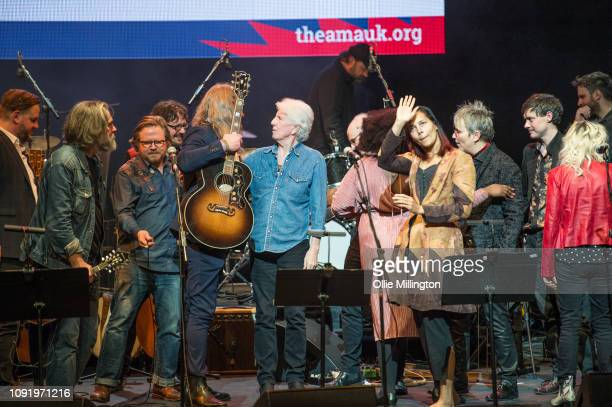 Ethan Jonhs Robin Bennett Israel Nash Graham Nash Rhannon Giddens and Mary Gaulteir onstage at the end of the UK Americana Awards 2019 held at...