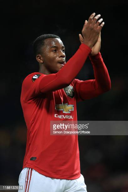 Ethan Laird of Man Utd applauds the support after the UEFA Europa League group L match between Manchester United and AZ Alkmaar at Old Trafford on...