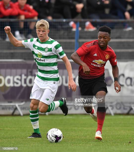 Ethan Laird of Manchester United and Scott Robertson of Celtic during the U19 NI Super Cup gala match at Coleraine Showgrounds on July 21 2018 in...