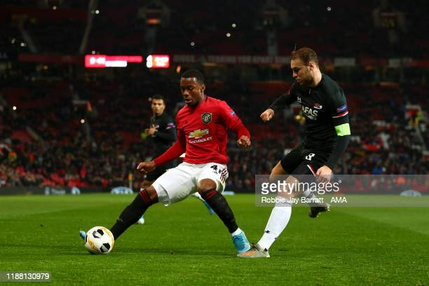 Ethan Laird of Manchester United and Teun Koopmeiners of AZ Alkmaar during the UEFA Europa League group L match between Manchester United and AZ...
