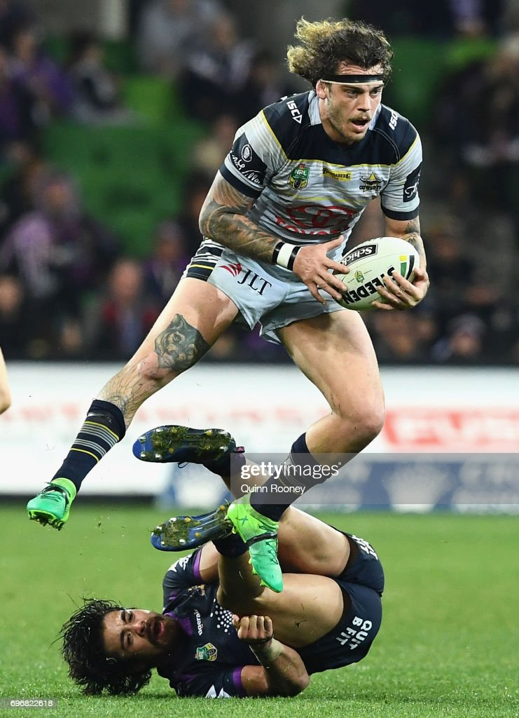 Ethan Lowe of the Cowboys breaks through a tackle by Young Tonumaipea of the Storm during the round 15 NRL match between the Melbourne Storm and the North Queensland Cowbpys at AAMI Park on June 17, 2017 in Melbourne, Australia.