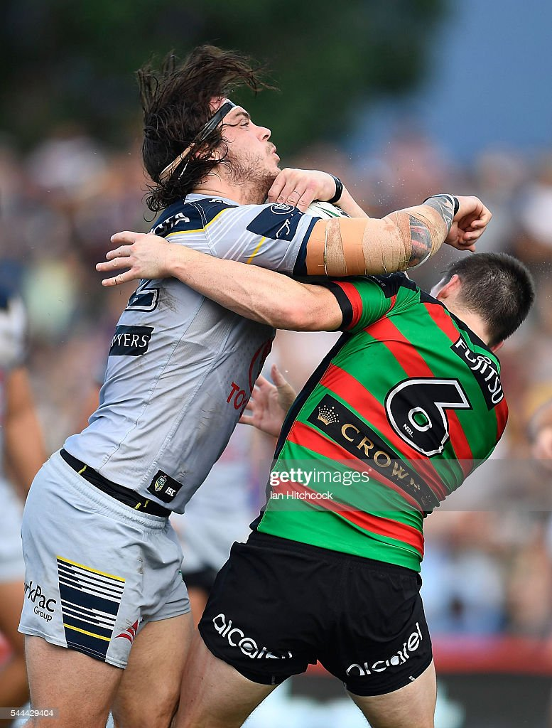 Ethan Lowe of the Cowboys is tackled by Luke Keary of the Rabbitohs during the round 17 NRL match between the South Sydney Rabbitohs and the North Queensland Cowboys at Barlow Park on July 3, 2016 in Cairns, Australia.