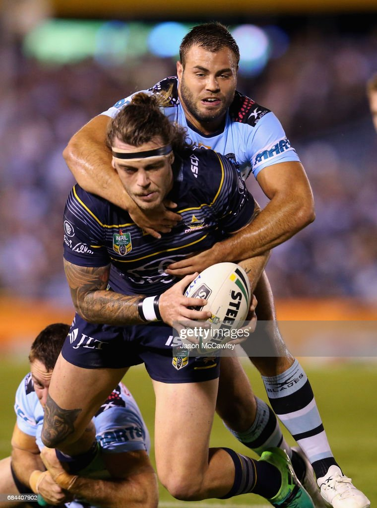 Ethan Lowe of the Cowboys is tackled by Wade Graham of the Sharks during the round 11 NRL match between the Cronulla Sharks and the North Queensland Cowboys at Southern Cross Group Stadium on May 18, 2017 in Sydney, Australia.