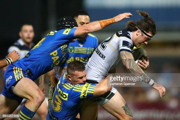 Ethan Lowe of the Cowboys is tackled during the round 14 NRL match between the Parramatta Eels and the North Queensland Cowboys at TIO Stadium on...