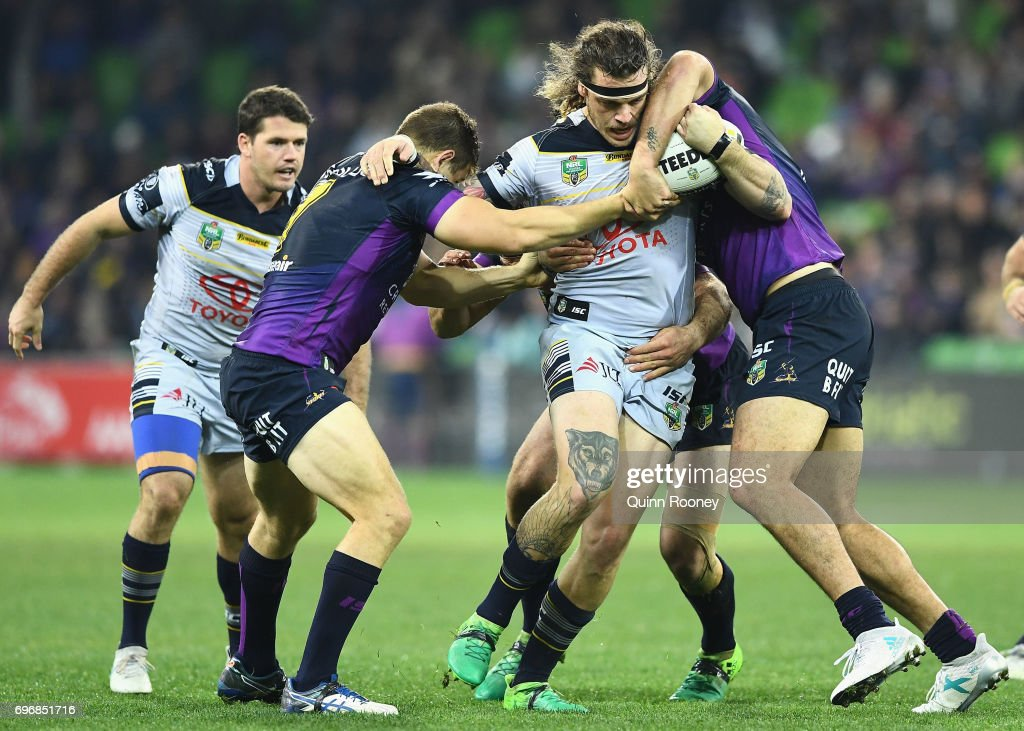 Ethan Lowe of the Cowboys is tackled during the round 15 NRL match between the Melbourne Storm and the North Queensland Cowboys at AAMI Park on June 17, 2017 in Melbourne, Australia.