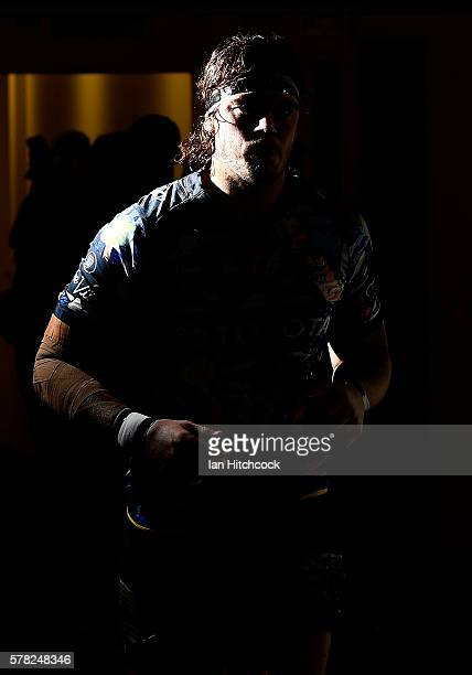 Ethan Lowe of the Cowboys runs out onto the field at the start of the round 20 NRL match between the North Queensland Cowboys and the Canterbury...