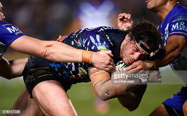 Ethan Lowe of the Cowboys surges to the try line to score his try during the round 20 NRL match between the North Queensland Cowboys and the...