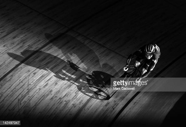 Ethan Mitchell of New Zealand leads Chris Hoy of Great Britain in the Men's Sprint 1/16 Finals during day three of the 2012 UCI Track Cycling World...