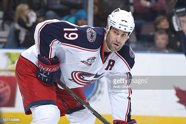 Ethan Moreau of the Columbus Blue Jackets concentrates on the puck against the Edmonton Oilers at Rexall Place on December 16 2010 in Edmonton...