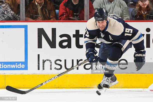 Ethan Moreau of the Columbus Blue Jackets skates with the puck against the Detroit Red Wings on March 17 2011 at Nationwide Arena in Columbus Ohio