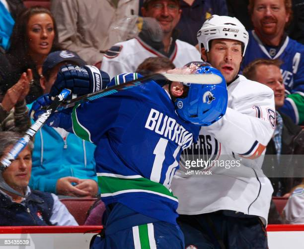 Ethan Moreau of the Edmonton Oilers high sticks Alex Burrows of the Vancouver Canucks during their game at General Motors Place on October 25 2008 in...