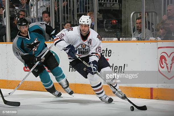 Ethan Moreau of the Edmonton Oilers skates with the puck during Game 2 of the Western Conference Semifinals against the San Jose Sharks on May 8,...